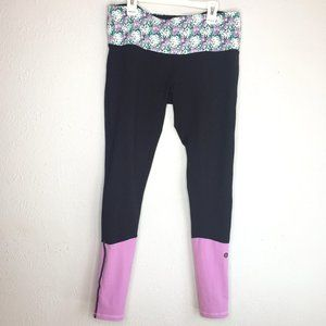 doTerra women's M, black and lilac leggings.